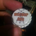 Bottlecap with the WCC website address